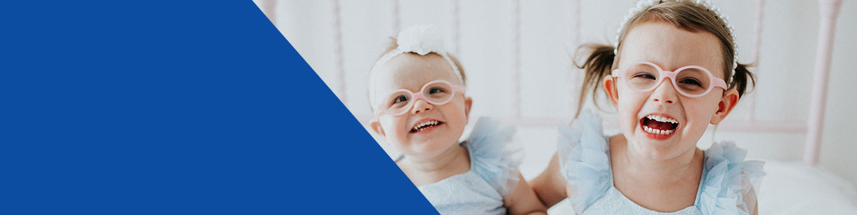 two young children with retinal blindness smiling